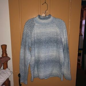 Women's blue mock neck sweater.